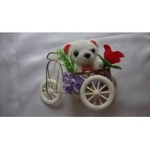 Miś w rowerze